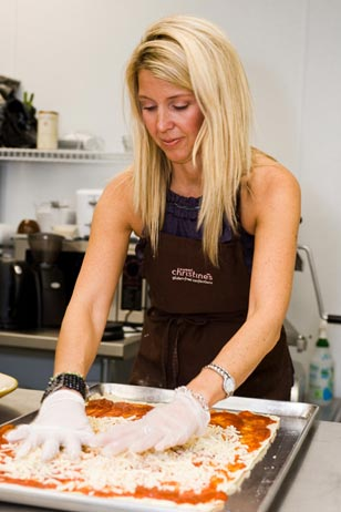 That's Amore<br>Owner Christine Ruggio prepares a delicious gluten-free pizza for her bakery.