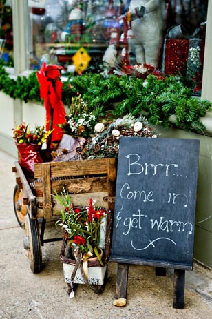 A vintage children's wagon brimming with holiday accents is a charming touch to welcome in passersby.