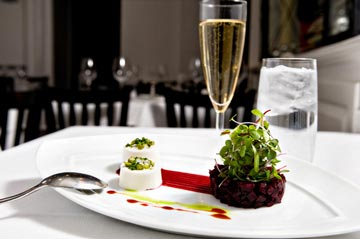 Parmesan panna cotta is accented with roasted ruby beets, balsamic vinaigrette and pistachios