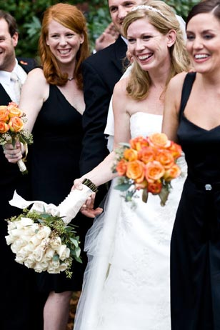 Sheryl Garman of Perfect Weddings recommends choosing concentrated pops of colors, as in Carolyn's bridesmaids' bouquets of roses, for the perfect touch of sophistication for a fall wedding.  Flowers courtesy of Cheryl Ann Floral Design, Conshohocken, PA.