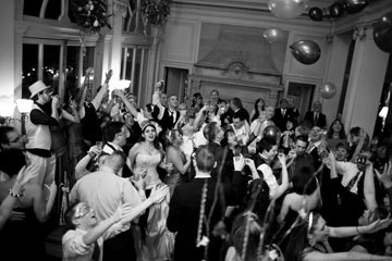 The rambunctious reception culminated with a festive ringing in of 2009 and a toast to the newlyweds.