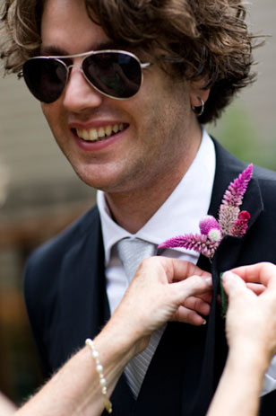 "The enterprising bride googled ""How to Make a Boutonniere"" and cleverly handcrafted her groom's from flowers purchased at Produce Junction."