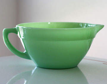 Smith fell in love with Jadite when she was putting away groceries for her grandmother one day and spotted her Fire King Jadite Batter Bowl, identical to the one pictured.