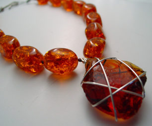 Amber Resin and Glass Necklace, $55. Peel's pieces are all one-of-a-kind, handcrafted works of art using some of the earth's most gorgeous gemstones.