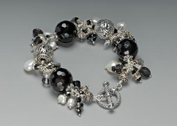 Tuyet Wong Bracelet: Black Spinel gemstones, Bali sterling silver, fresh water pearl, mother of pearl, Swarovski crystals.