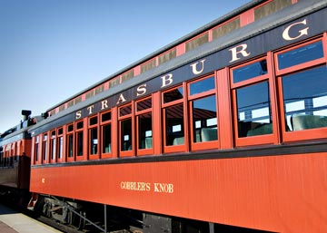 Riders of the Strasburg Railroad experience an authentic vintage steam train, warmed by a potbelly stove, that travels past more than 1,000 acres of picturesque farmland on the way to Paradise, PA.