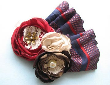 Picnic in the Park, perfect for Memorial Day and Fourth of July, is handmade with reclaimed fabrics and an antique scarf. It can be worn as a brooch or hair clip. $26