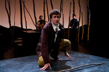 Aubie Merrylees as David Balfour (foreground), Peter DeLaurier as the Troubadour and Matthew Allison as the Musician (background) in KIDNAPPED!, an adaptation of the Robert Louis Stevenson novel, by Ernie Joselovitz, at People's Light & Theatre.