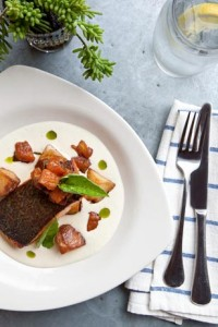 Silverspoon's crispy salmon with potato and leek soubise with roasted tomato basil compote. Photo courtesy of Courtney Apple Photography