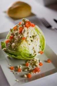 Sullivan's Famous Iceberg Lettuce Wedge with Vine Ripe Tomatoes, Crumbled Blue Cheese and Blue Cheese Dressing