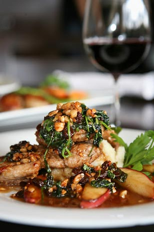 Cashew Encrusted Pork Apples, Raisins, Baby Spinach, Garlic Mashed Potatoes & Natural Jus