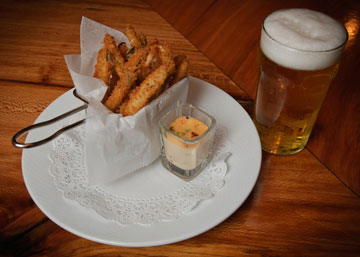 Ella's famous fried pickles will be part of the complimentary appetizers to be enjoyed in the bar on Friday, April 27th!