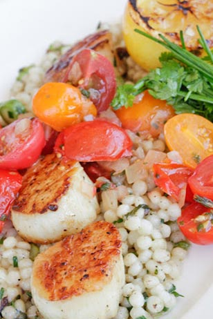 Delicious seared sea scallops with sweet and sour tomatoes and couscous are a new addition to The Capital Grille's 3-course summer plates menu.  Available Monday through Friday for only $18!
