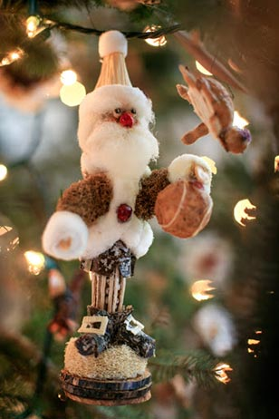 Fabulous 'critter' ornaments, created from natural materials by Conservancy volunteers, adorn seven fresh-cut fir trees on the first and third floors.