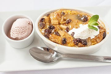 The Gables' Apple and Quince Bread Pudding with Cinnamon Raisin Ice Cream and Warm Caramel Cognac Sauce