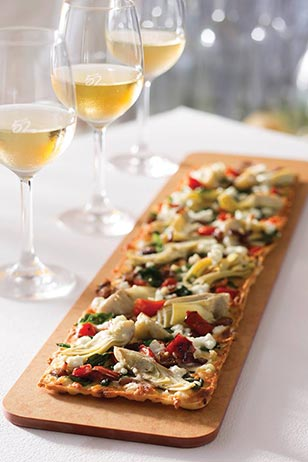 "Season 52's Grilled Artichoke and Goat Cheese Flatbread One lucky local foodie will win a $52 gift certificate to Seasons and a beautiful ""52"" Wine Glass Set and stoppers by participating in our comment section below. Good Luck!"