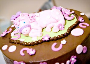 A yummy yellow cake with chocolate butter cream icing courtesy of Philly's Whipped Bakeshop was the perfect accent to the pony-themed party.