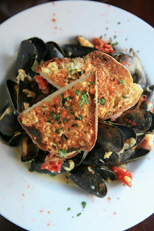 An excellent choice on Redhound Grille's 3-course, $25 Mother's Day menu: Steamed Mussels in Lager with Smoked Gouda, Sun Dried Tomatoes and House-Cured Bacon served with Garlic Bread